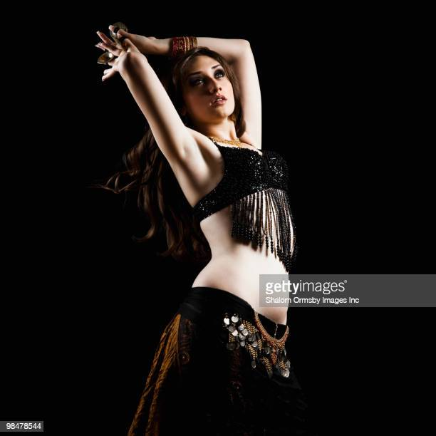 mixed race woman belly dancing - belly dancing stock photos and pictures