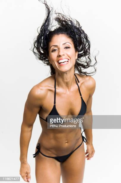 mixed race woman body builder flipping hair - female body hair stock photos and pictures