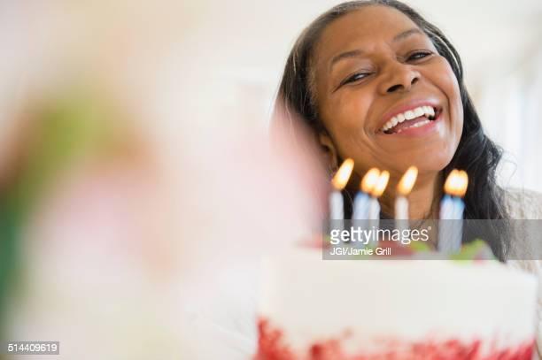 Mixed race woman celebrating birthday