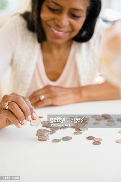 Mixed race woman counting change