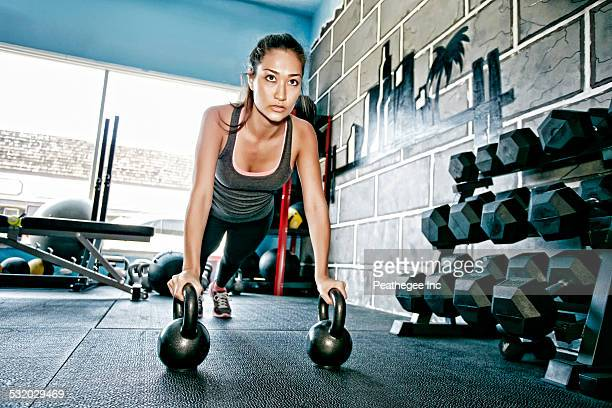 Mixed race woman exercising in gym