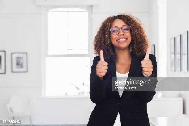 Mixed race woman gesturing in gallery