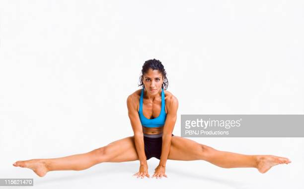 Mixed race woman gymnast balancing on hands