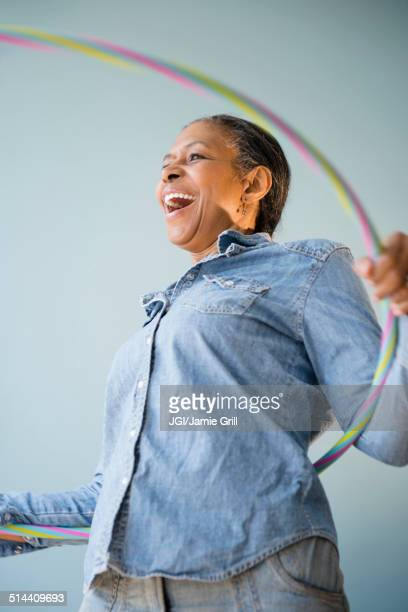 Mixed race woman holding plastic ring