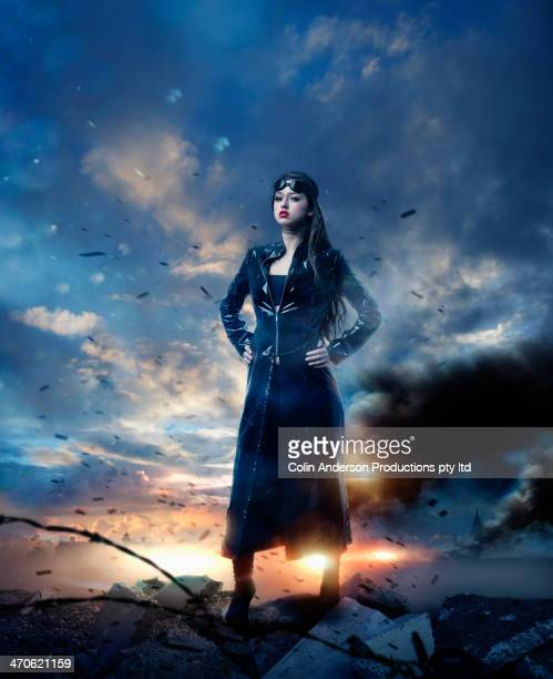 mixed race woman in apocalyptic landscape - hero stock photos and pictures