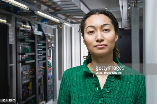Mixed Race woman in computer server room