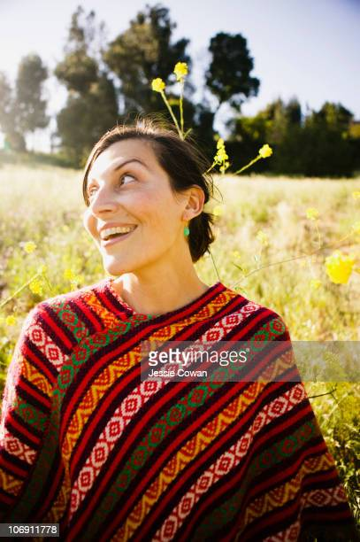 Mixed race woman in field