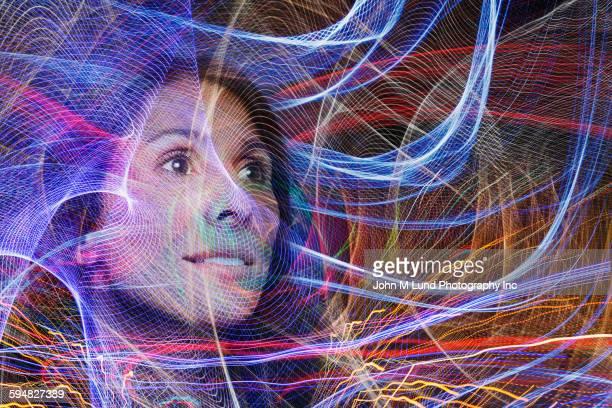 mixed race woman in light streams - compuesto digital fotografías e imágenes de stock