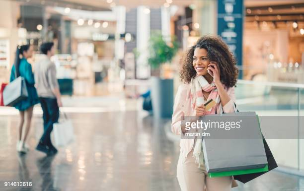 mixed race woman in the shopping center - shopping mall stock pictures, royalty-free photos & images
