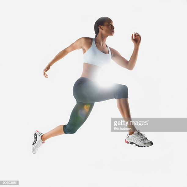 Mixed race woman jumping in mid-air