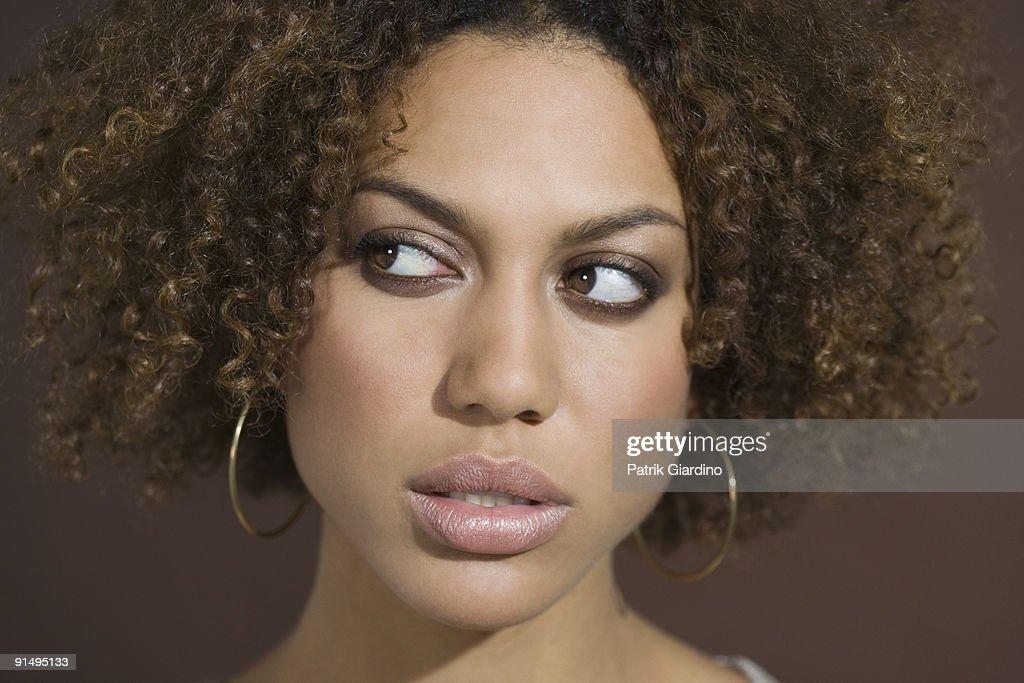 Mixed Race woman looking sideways : Stock Photo