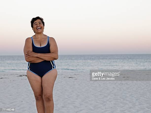 mixed race woman on beach - fat old lady stock photos and pictures