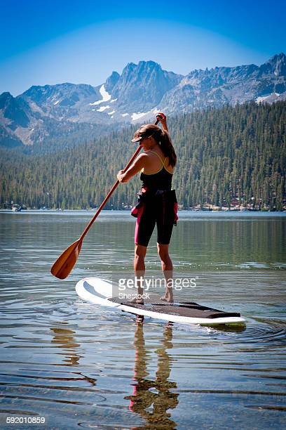 Mixed race woman on paddle board in Lake Tahoe, California, United States