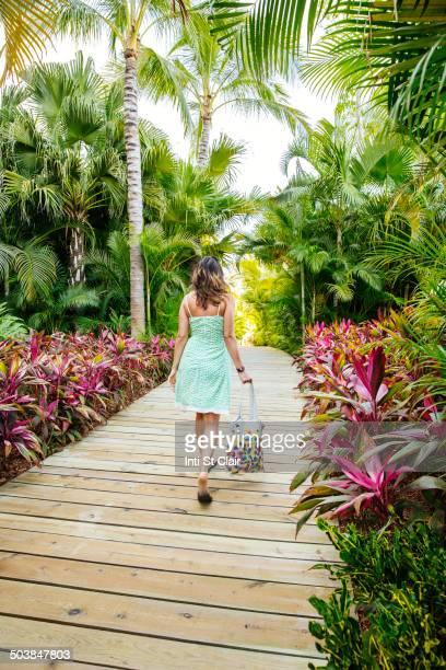 Mixed race woman on tropical walkway