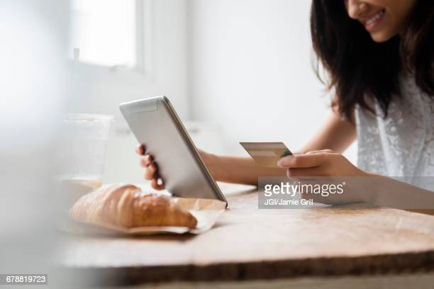 Mixed Race woman online shopping with credit card