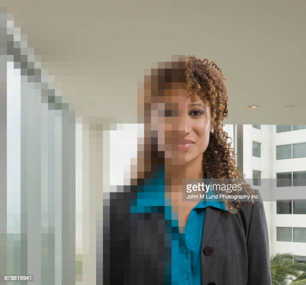 mixed race woman partially pixelated - pixels stock photos and pictures