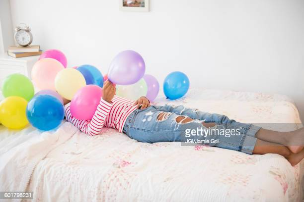 Funny birthday images free stock photos and pictures getty images mixed race woman playing with balloons voltagebd Gallery