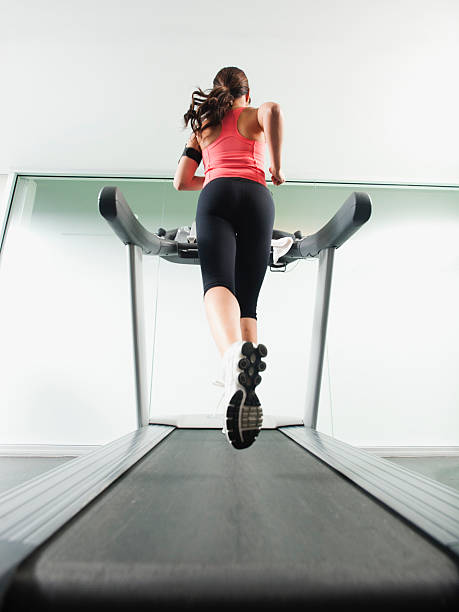 Mixed Race Woman Running On Treadmill Wall Art