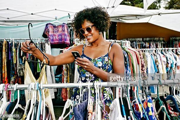 Mixed race woman shopping at flea market