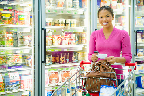 Mixed race woman shopping in frozen food aisle - gettyimageskorea