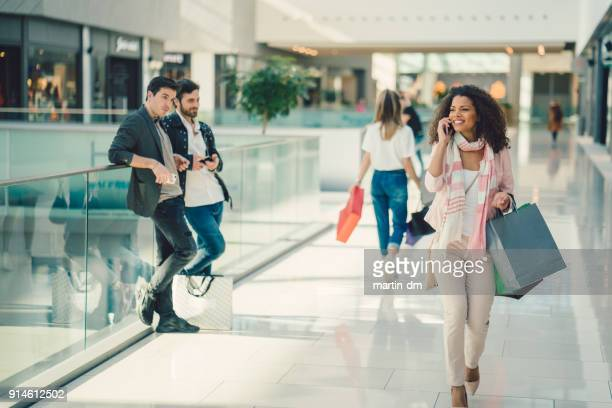 mixed race woman shopping - staring stock pictures, royalty-free photos & images