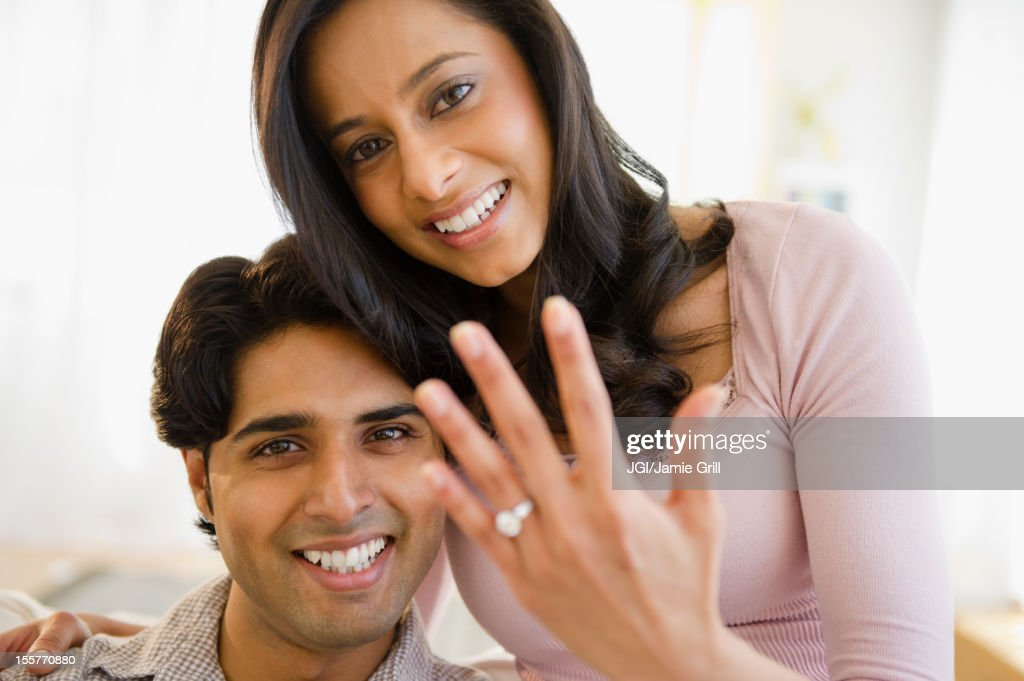 Mixed race woman showing off engagement ring : Stock Photo