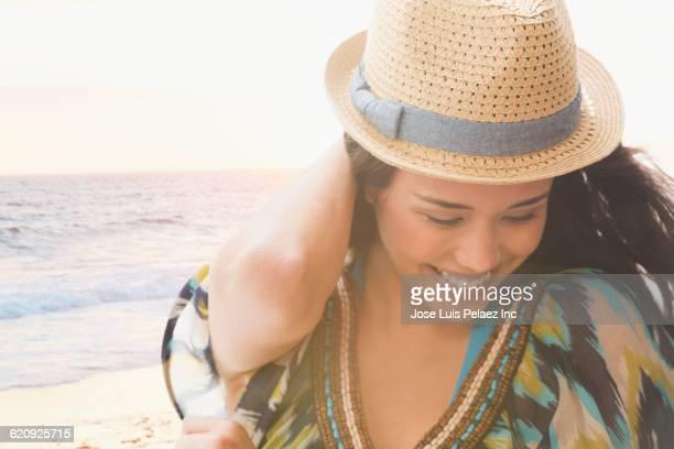 mixed race woman smiling on beach - città di west new york new jersey foto e immagini stock