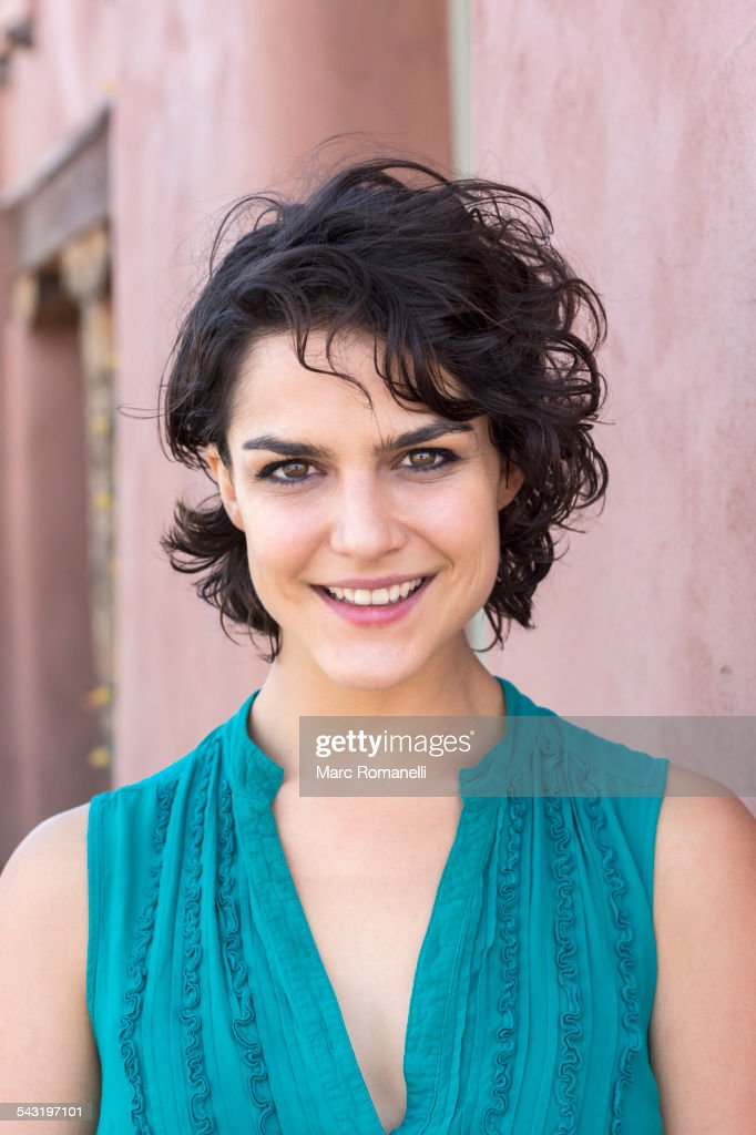 Mixed race woman smiling outdoors : Stock Photo