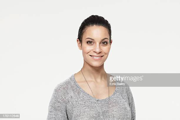 mixed race woman smiling. - hair back stock pictures, royalty-free photos & images