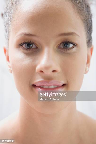 mixed race woman smiling - one young woman only stock pictures, royalty-free photos & images