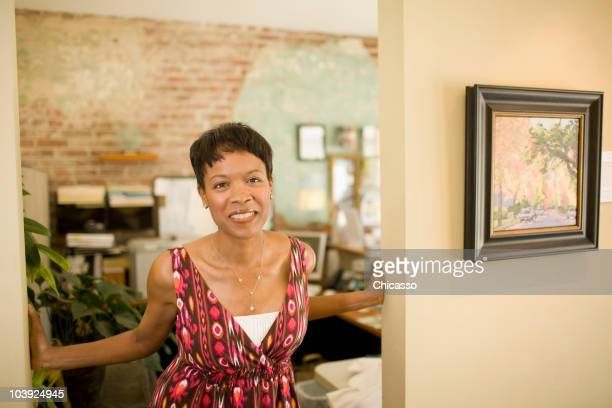 mixed race woman standing in doorway - painting art product stock pictures, royalty-free photos & images