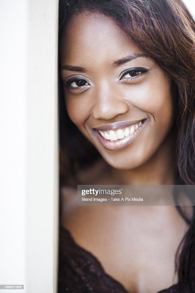 Mixed race woman standing in doorway : Stock Photo