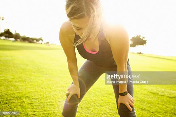 Mixed race woman standing in field after exercise