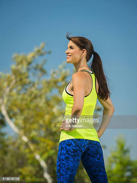 Mixed race woman standing in park