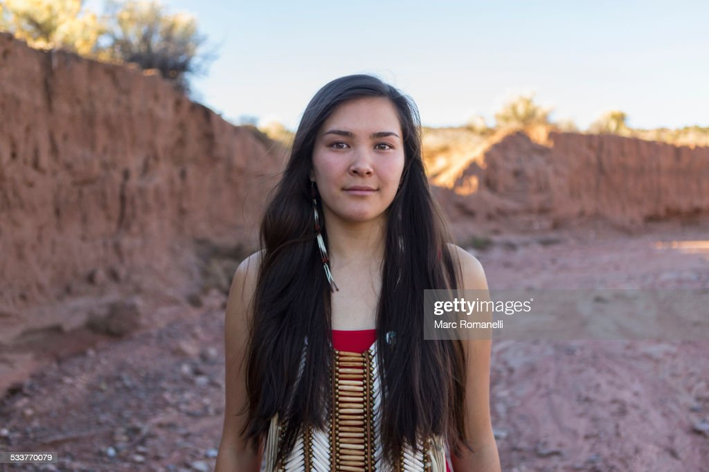 Mixed race woman standing in remote desert landscape : Stock Photo