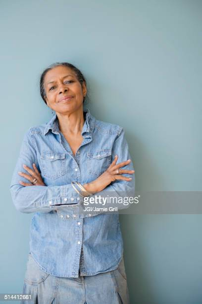 Mixed race woman standing with arms crossed