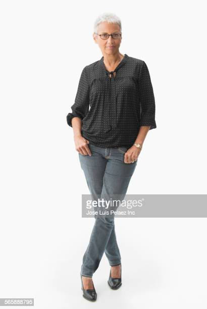 mixed race woman standing with thumbs in pockets - full length stock pictures, royalty-free photos & images