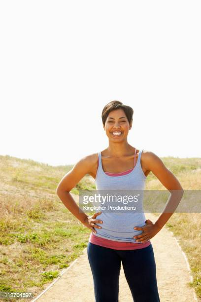 Mixed race woman stopping on remote path