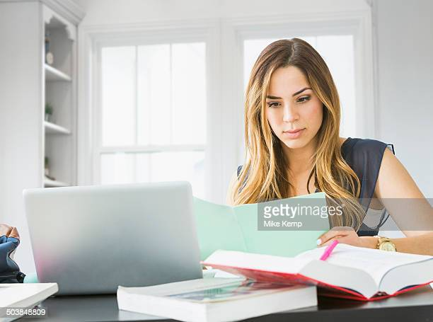 Mixed race woman studying at home