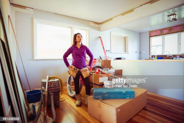 Mixed race woman surveying remodeling project