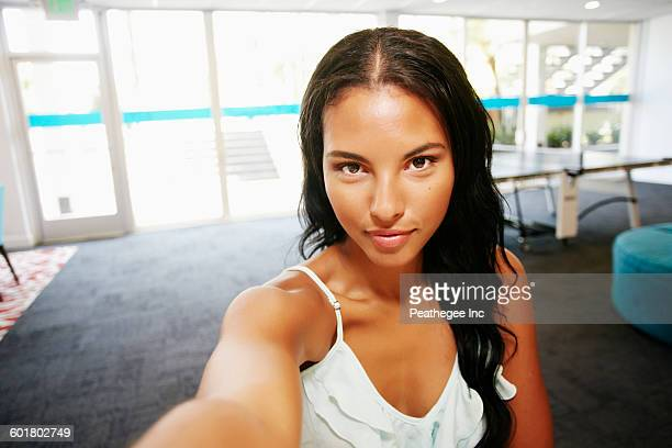 Mixed race woman taking selfie
