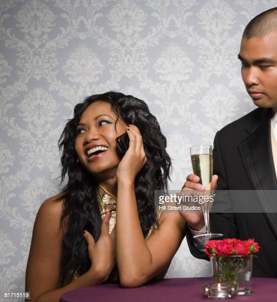 Mixed Race woman talking on cell phone