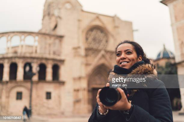 mixed race woman traveling single in europe,plaza de la virgen,valencia - valencia spain stock pictures, royalty-free photos & images