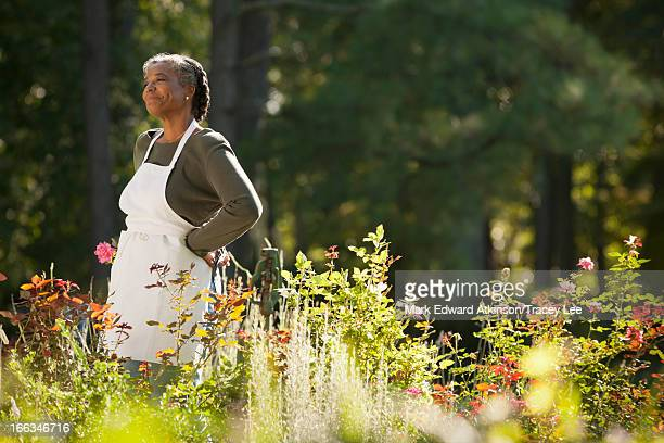 mixed race woman wearing apron in field - cherokee indian women stock pictures, royalty-free photos & images