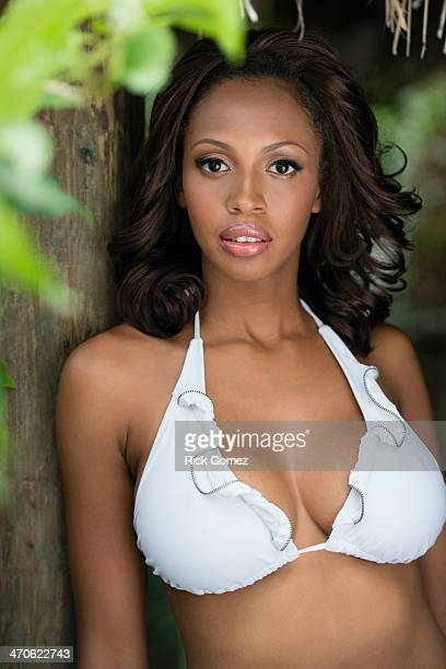 mixed race woman wearing bikini - black women stock photos and pictures