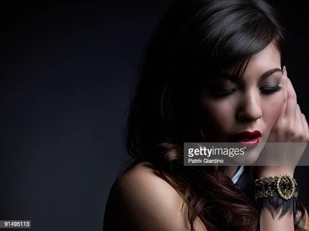 Mixed Race woman wearing bracelet