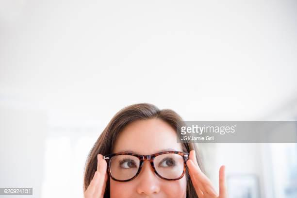 Mixed race woman wearing eyeglasses
