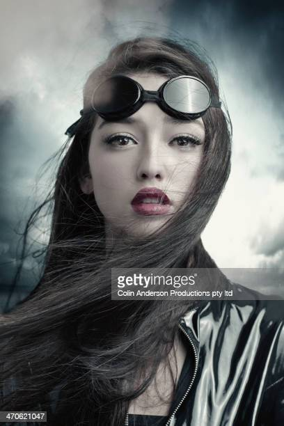 Mixed race woman wearing goggles