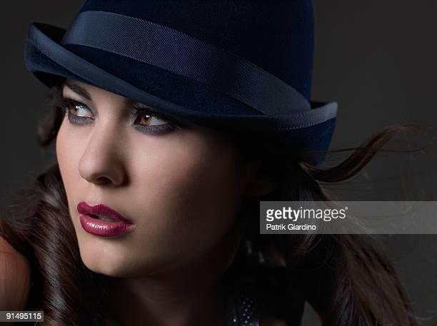 Mixed Race woman wearing hat