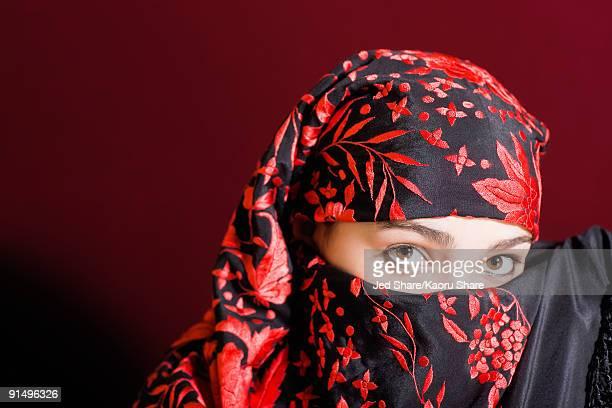 Mixed race woman wearing headscarf